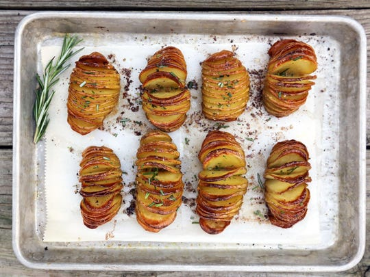 A roasted potato side side dish with chives and rosemary