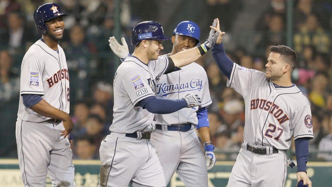 U.S. All Star Evan Longoria, second left, celebrates with teammate Jose Altuve, right, after hitting a grand slam against Japan's Giants/Tigers team in the fifth inning in Nishinomiya, Japan on Tuesday.
