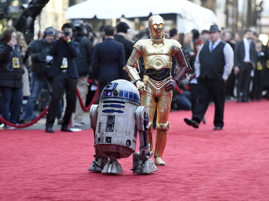 "Film characters R2-D2, left, and C-3PO arrive at the world premiere of ""Star Wars: The Force Awakens"" at the TCL Chinese Theatre on Monday, Dec. 14, 2015, in Los Angeles. (Photo by Jordan Strauss/Invision/AP)"