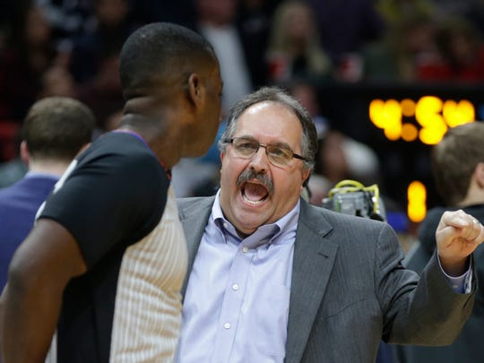 Detroit Pistons' Stan Van Gundy, right, talks with