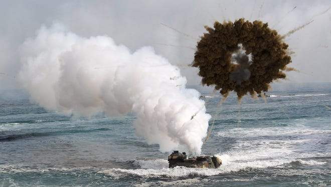 In this file photo, a South Korean marine LVT-7 landing craft sail to shores through a smoke screen during the U.S.-South Korea joint landing exercises in Pohang, South Korea, March 31, 2014.