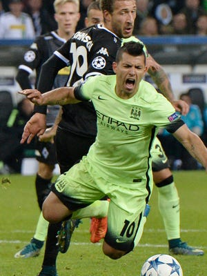 Manchester City's Sergio Agüero is fouled for a penalty during the Champions League group D soccer match against Borussia Moenchengladbach.