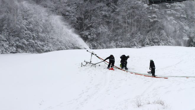 A mountain operations crew blows snow at Sugarbush Resort in Warren. The resort has reportedly used 235 million gallons of water to make snow this season, an increase of 30 percent over a typical season.
