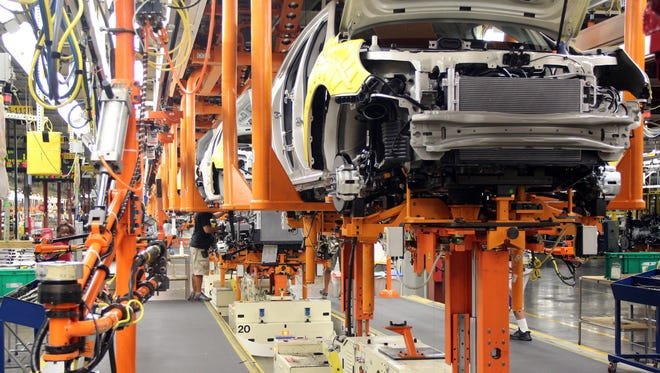General Motors will idle four plants, including Spring Hill Assembly, because of a parts shortage. This photo is from Aug. 1, 2013.