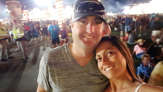 Chad Robertson, left and Jennifer Robertson, right, pose for a selfie on Sunday, Oct. 1, 2017, at the Route 91 Harvest Festival shooting in Las Vegas, Nev. The photo was taken 30 minutes before the shooting took place.
