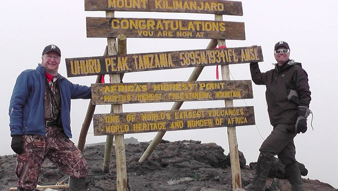 Gerald (Jerry) Essenmacher, 74, of Washington Township and his son Aaron Essenmacher, 45, of Warren took the D to Mt. Kilimanjaro, elevation 19,341 feet, in Tanzania, Africa, in July. The pair hiked 29 miles up in seven days and hiked 13 miles down in two days for a total of 42 miles in nine days. The route going up was longer because they had to become acclimated to the different oxygen levels. They took different trails going up and down.