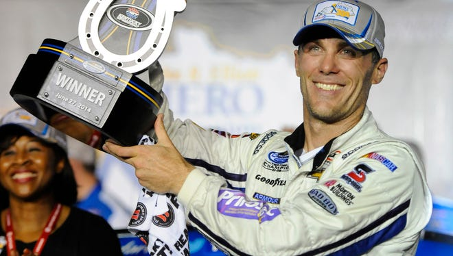 Kevin Harvick celebrates his triumph in the Nationwide Series race at Kentucky Speedway on Friday.