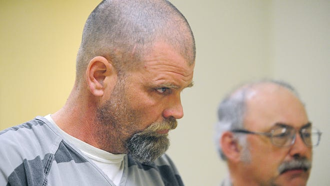 Chad Christopher Riedel, 44, is escorted into a Minnehaha County courtroom Friday.