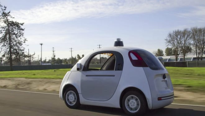 Google's fleet of autonomous cars, like this one in Mountain View, California, could hit the road in the next five years.