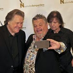 Nashville Songwriters Hall of Fame Foundation inductees Craig Wiseman, center, takes a selfie with Mark James, left, and Even Stevens after a news conference in July in Nashville.