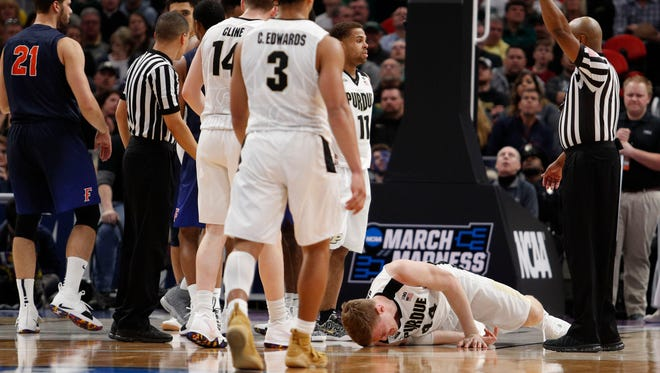 Purdue Boilermakers center Isaac Haas (44) lays on the ground after an injury in the second half against the Cal State Fullerton Titans in the first round of the 2018 NCAA Tournament at Little Caesars Arena.