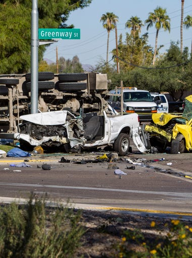 A three-vehicle accident, including a cement truck, is pictured on Wednesday, Dec. 17, 2015 near Brown Road and Stapley Drive in Mesa, Ariz.