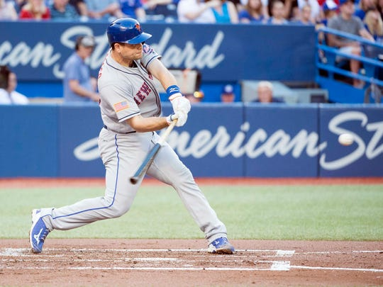 Jul 3, 2018; Toronto, Ontario, CAN; New York Mets catcher Devin Mesoraco (29) hits a two run home run during the second inning against the Toronto Blue Jays at Rogers Centre.