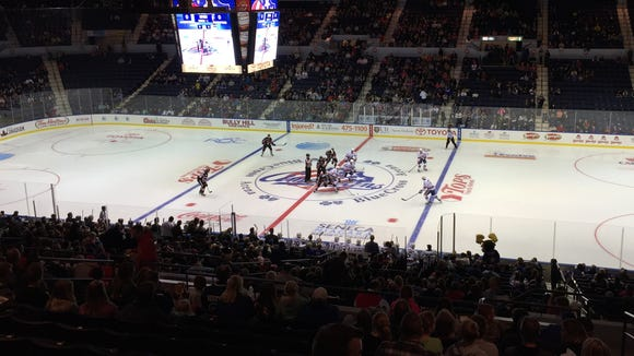 Binghamton Senators fight with the Rochester Amerks for the opening faceoff on Friday.