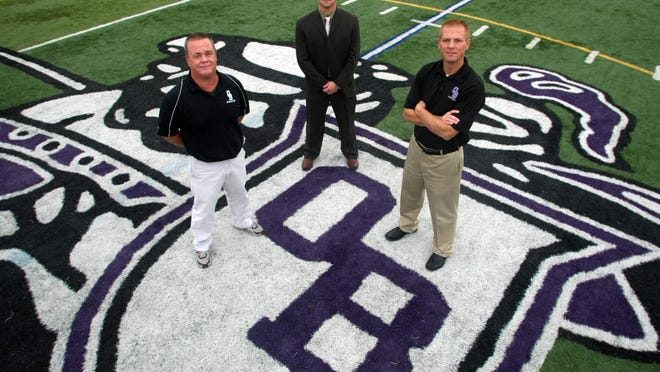 Old Bridge High School athletics director Bob Eriksen, principal Vincent Sasso and head football coach Anthony Lanzafama stand on the Old Bridge football field on Tuesday. JASON TOWLEN/Staff Photographer Old Bridge, NJ - (L to R) Old Bridge High School Athletics Director Bob Eriksen, Principal Vincent Sasso and head football coach Anthony Lanzafama on the Old Bridge football field, Tuesday, October 23, 2012, at Carl Sandburg Middle School.