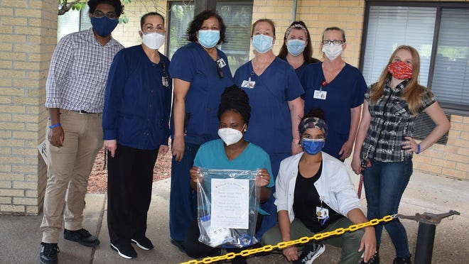 Sussex County Community College students Scott Raghbubir, far left, and Lillian Kornmeyer, far right, pose with health care workers at the Andover Subacute and Rehabilitation Center facility after donating masks Friday, May 29.