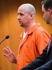 John Wesley Coker, 53, left, of Anderson, standing