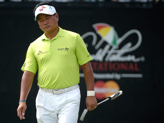 K.J. Choi, of South Korea, reacts after missing a birdie putt on the 17th