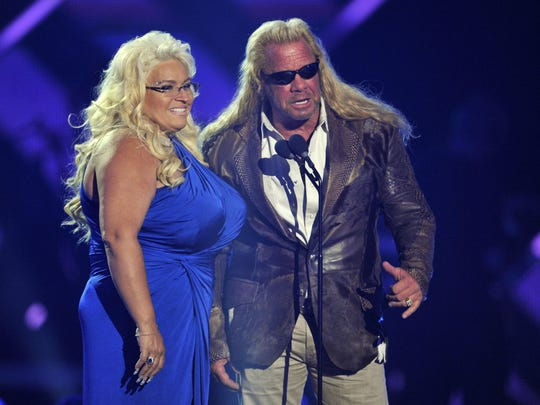 """In this June 5, 2013, photo, Duane """"Dog"""" Chapman, right, and Beth Chapman present the award for CMT performance of the year at the CMT Music Awards at Bridgestone Arena in Nashville, Tenn. Chapman, the wife and co-star of """"Dog the Bounty Hunter"""" reality TV star Duane """"Dog"""" Chapman, died on June 26, 2019."""