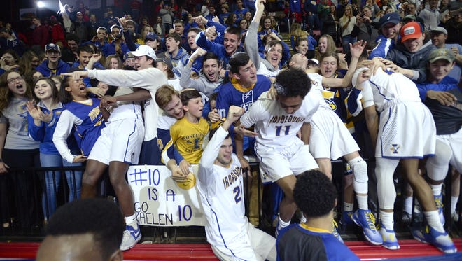 Irondequoit fans and players celebrate their win following the NYSPHSAA Boys Basketball Championships Class A final in Binghamton on March 19, 2017. Irondequoit won the Class A state title 54-43 over Our Lady of Lourdes-I.