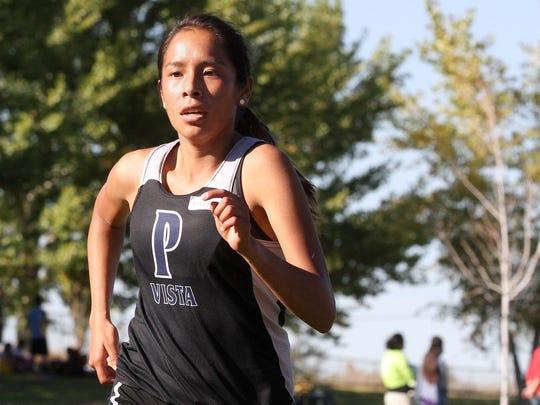 Piedra Vista's Paris Chee competes in the Kirtland Ridge Run on Friday at Kirtland Elementary School.