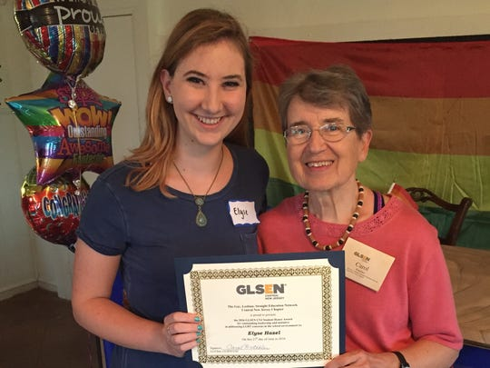 Carol Watchler (right), co-chairperson of the Central New Jersey chapter of GLSEN, poses with Brookdale Community College student Elyse Hazel after Hazel was honored for hosting the 2015 GSA Forum.
