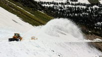 Crews on Thursday busted through the last of the notorious Big Drift near Logan Pass, clearing Going-to-the-Sun Road of snow.