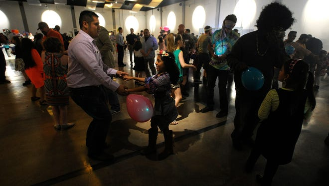 Daniel Lopez dances with his daughter Adrienne, 8, during the city of Abilene's Daddy Daughter Date Night on Thursday, Feb. 9, 2017, at the Abilene Convention Center.