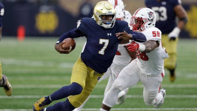 Notre Dame quarterback Brandon Wimbush is tackled by North Carolina State's Airius Moore during their game in 2017.