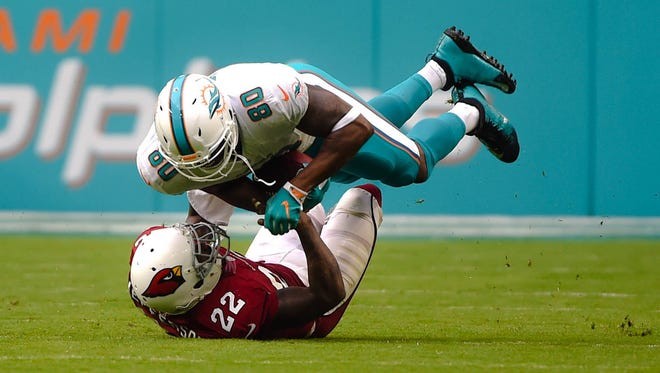 Arizona Cardinals strong safety Tony Jefferson (22) tackles Miami Dolphins tight end Dion Sims (80) during the second half at Hard Rock Stadium.