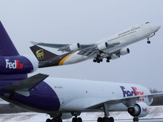 Cargo jets for UPS, top, and FedEx, bottom, trade places