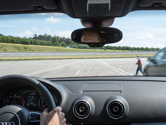 Bosch engineers test a system designed to help detect pedestrians and trigger automatic emergency braking. The system is available in Europe, but U.S. automakers have been slow to adopt the technology.