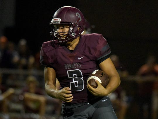 Flour Bluff's Simeon Wells rushes up field against