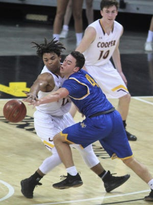 Cooper senior Braydon Runion and NCC senior Brennan Hall collide during a Ninth Region boys basketball quarterfinal between Newport Central Catholic and Cooper March 1, 2018 at BB&T Arena, Highland Heights KY.