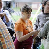 """Lena Dunham, center, director and star of the HBO television show """"Girls,"""" talks with others on the set of the show that was being filmed on campus in January at SUNY New Paltz."""