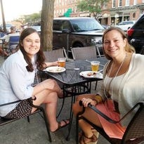 Diners, from left, Carolyn Fortenberry, Samantha Fortenberry, Christine Kee and Trisha Kee enjoy an outdoor patio in Brighton.