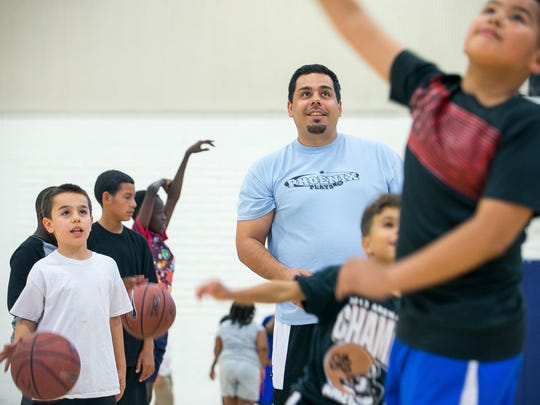 Eddie Martinez coaches his basketball team at South Mountain Community Center in Phoenix. April 2015.