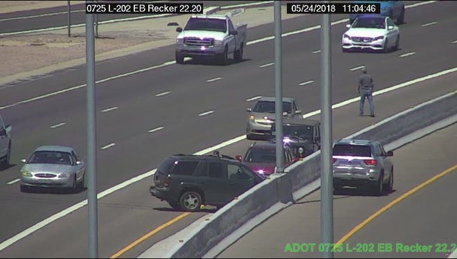 A man was killed while assisting others during an accident on Loop 202 in Mesa Thursday.