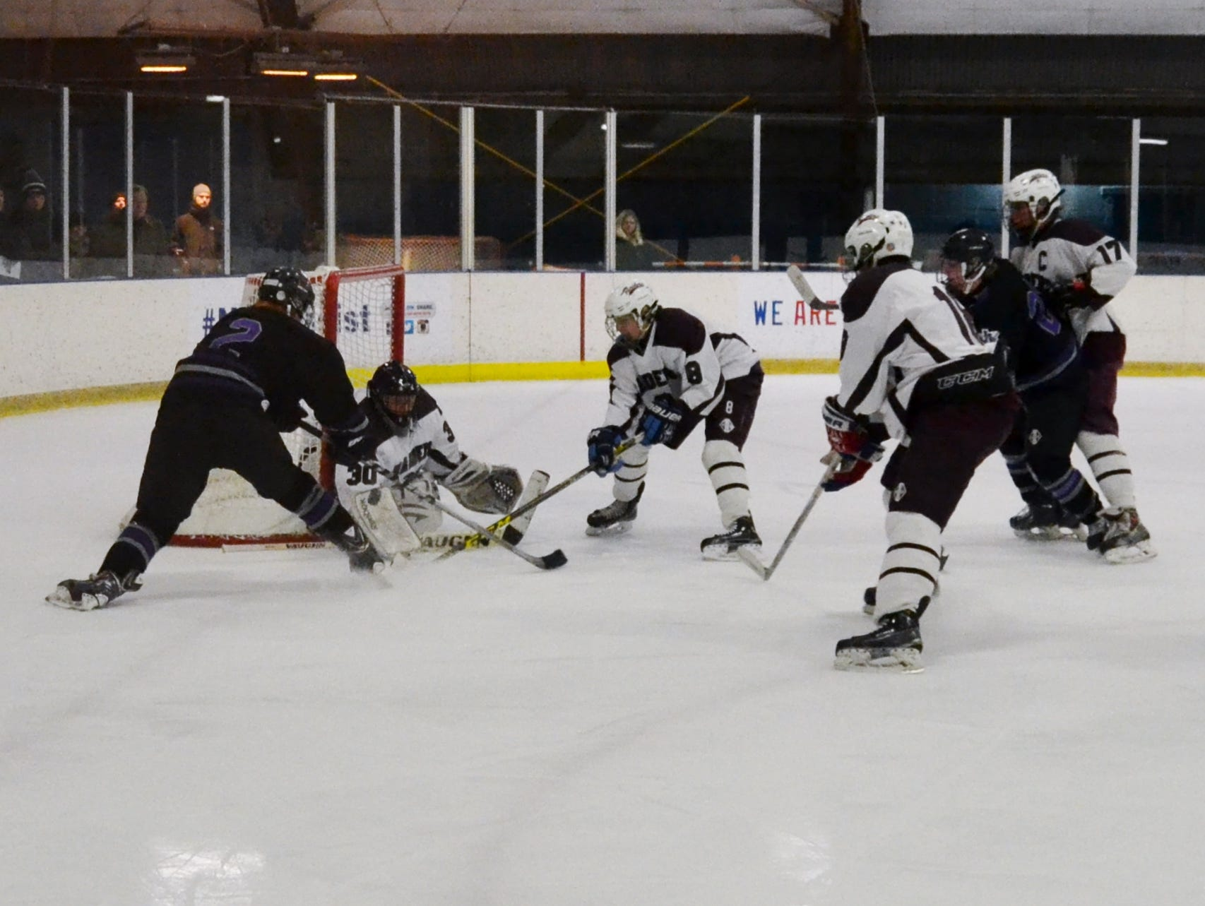 Scarsdale goalie Sam Seltzer prevents Sean Blaney (2) from scoring in the second period Friday at E.J. Murray Skating Center. The Raiders pulled away in the third period and posted a 7-4 win.
