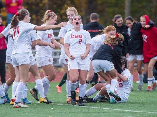 Champlain Valley Union's Ali Bisaccia celebrates the win over Burr & Burton in the girls Division 1 high school state championships in Burlington on Saturday, November 4, 2017.