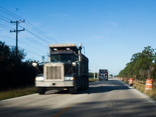 Sand trucks drive toward Alico Road on Tuesday, Nov. 1, 2016, in Estero, Florida. Trucks use Alico Road, just off of Corkscrew, to access mines for Collier County's beach renourishment project.