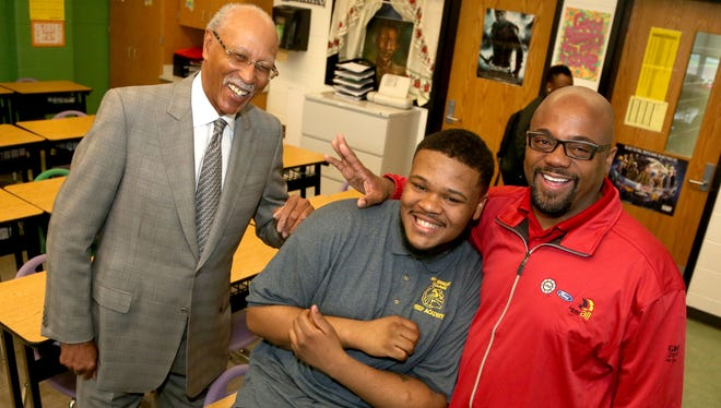 Inside a classroom at the East English Village Preparatory Academy in Detroit on Wednesday, April 6, 2016, (L to R) former Detroit Mayor Dave Bing laughs with sophomore Orlando Evans, 16, and his BINGO mentor Darryl Nolen, an administrative assistant with the UAW.