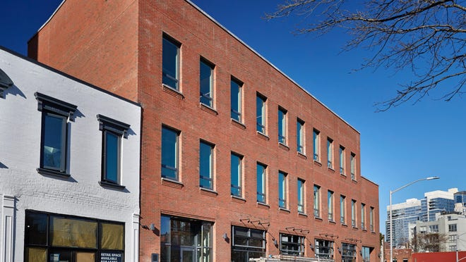 Timber office buildings like this one in Brooklyn's Williamsburg neighborhood are part of a nationwide trend.