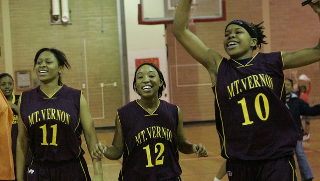 From left, Mount Vernon's Romona Miles, Carece Moore and Nadia Duncan celebrate their teams 56-50 victory over North Rockland in the Class AA Girls Basketball Quarterfinal at North Rockland High School in Thiells Feb. 21, 2007.