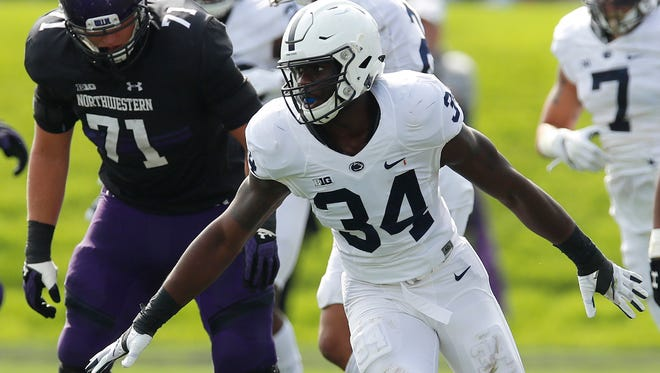 Penn State Nittany Lions defensive end Shane Simmons celebrates a sack on Northwestern Wildcats quarterback Clayton Thorson at Ryan Field.