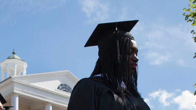Mary Baldwin College students walk to Page Terrace during their graduation ceremony as part of the academic processional in Staunton on Sunday, May 18, 2013.