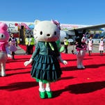 LOS ANGELES, CA - SEPTEMBER 18:  'Hello Kitty' and dancers celebrate the arrival of the EVA Boeing 777-300ER Hello Kitty Jet at LAX Airport on September 18, 2013 in Los Angeles, California.  (Photo by Mark Sullivan/WireImage) ORG XMIT: 181045133 ORIG FILE ID: 180991567
