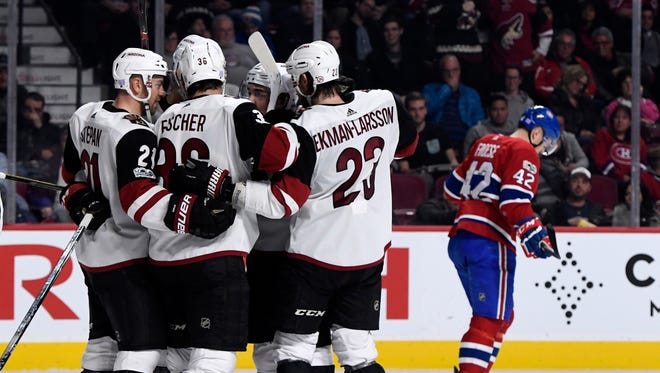 Arizona Coyotes forward Christian Fischer (36) celebrates with teammates after scoring a goal against the Montreal Canadiens during the third period at the Bell Centre.