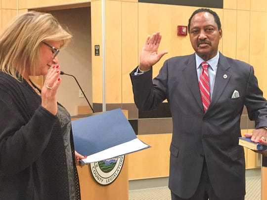 Deputy County Clerk Donna Gorman Silberman (left) administered the oath of office to Toney Earl as chair of the Rockland County Legislature while his wife, Idette, held the Bible, in the 2018 photo.