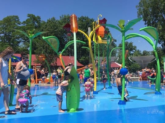 Hundreds of visitors enjoy the new splash pad at Dodge Park in Sterling Heights on its first day June 28, 2018. The splash pad is part of several upgrades to the park and other parks in the state's fourth largest city as part of a $45-million recreation plan approved by voters through a millage in 2016.